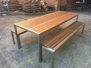 STAINLESS STEEL TIMBER OUTDOOR TABLE SETTING. CAN CHANGE SIZE