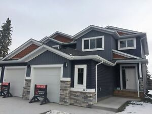 Absolutely stunning homes in Sylvan Lake all with a  GARAGE!