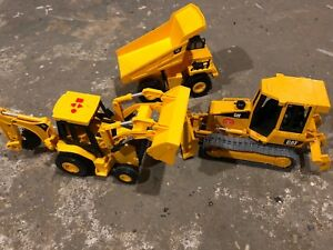 3 CAT construction vehicles