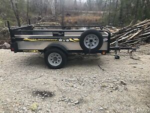 Solid 4x8 one ton capacity dumping trailer with built-in ramp