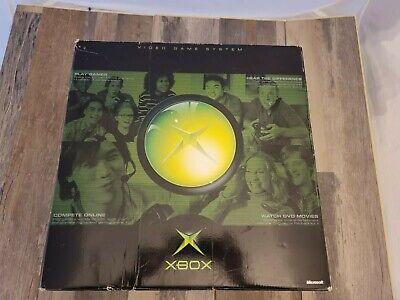 Original Microsoft Xbox console in plastic and original box.