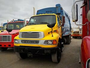 Only two left!  2008 sterling rear load garbage trucks!