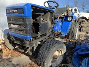 Ford blue original tractor with lawn mower attachment