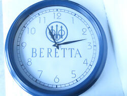 Large 18 across Berretta Fire Arms Wall Clock. Takes AA Battery & is Included