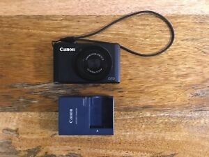 Canon S110 camera with case and spare battery charger