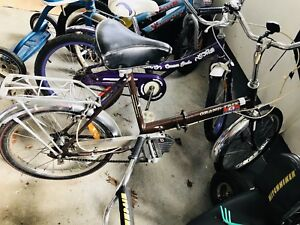 Antique folding bike. Antique tricycle and child rider