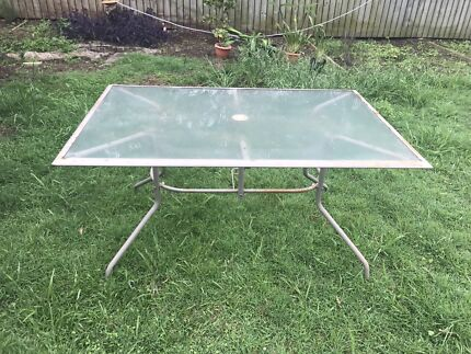 Glass table with metal frame