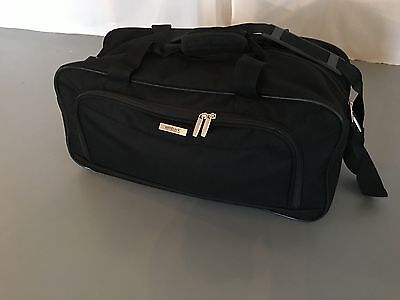 Small black travel duffle bag suitcase measures approx 21