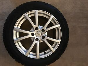 225/55/17 Winter tires with alloy rims