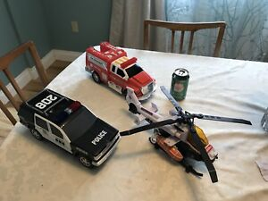 Tonka helicopter, fire and police trucks