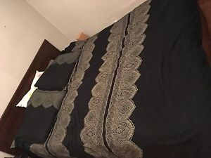 Brusali queen sized bed with mattress and nightstand