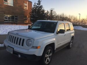 White Jeep Patriot with extended Platinum Warranty