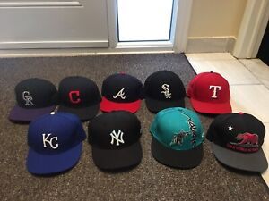 Various New Era fitted hats.