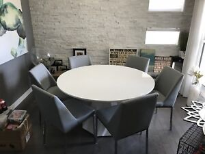 White table and grey chairs