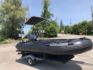 Loaded Military Inflatable, outboard and trailer