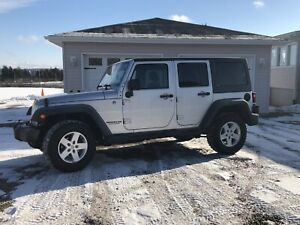 2011 Jeep Wrangler unlimited only 115kms  will trade