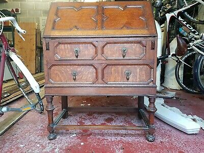 Antique vintage 2 drawer oak writing desk with brass fittings.