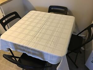 Dining table with 4 foldable chairs moving sale in black