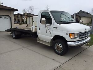 2002 Ford E350 flat deck tow truck, 212Kms, New Tires $10,700