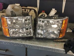 Head lights for a 2011 GMC Sierra