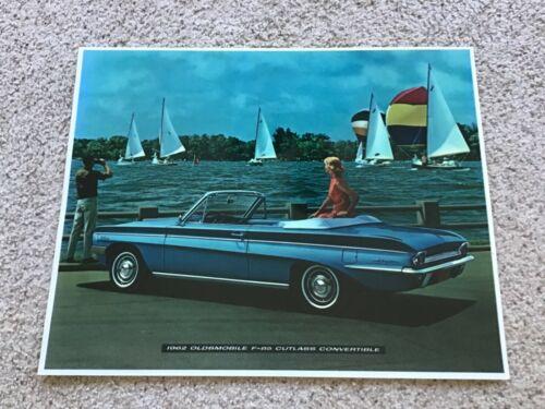1962  Oldsmobile F-85 Cutlass convertible, dealership display sign.