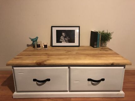 Solid coffee table with drawers