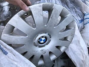 4 Bmw hub caps and tires with rims for sale