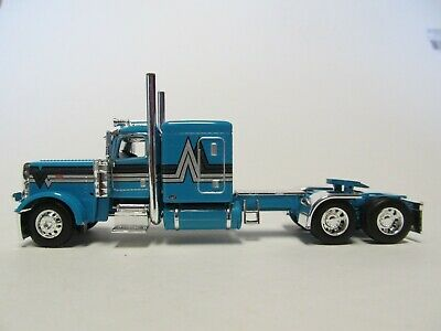 DCP FIRST GEAR 1/64 SCALE 389 PETERBILT FLAT TOP, TEAL WITH BLACK/ SILVER STRIPE 1