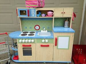 Wood toy kitchen with grocery cart, food & dishes