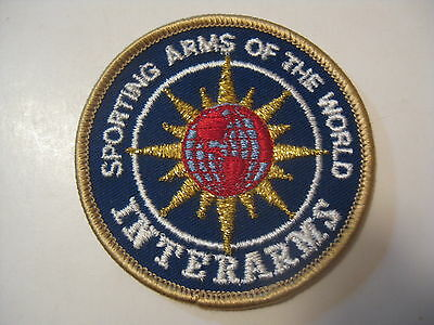 VINTAGE UN SEWN NOS INTERARMS SPORTING ARMS HUNTING / SHOOTING CLOTH PATCH