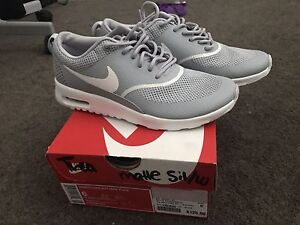New Grey Nike Thea's size 6