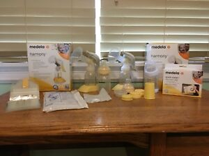 2 Medela Harmony Breast Pumps with lots of extra parts