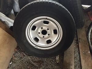 Brand new tires and rims for a Dodge Ram 1500 truck.