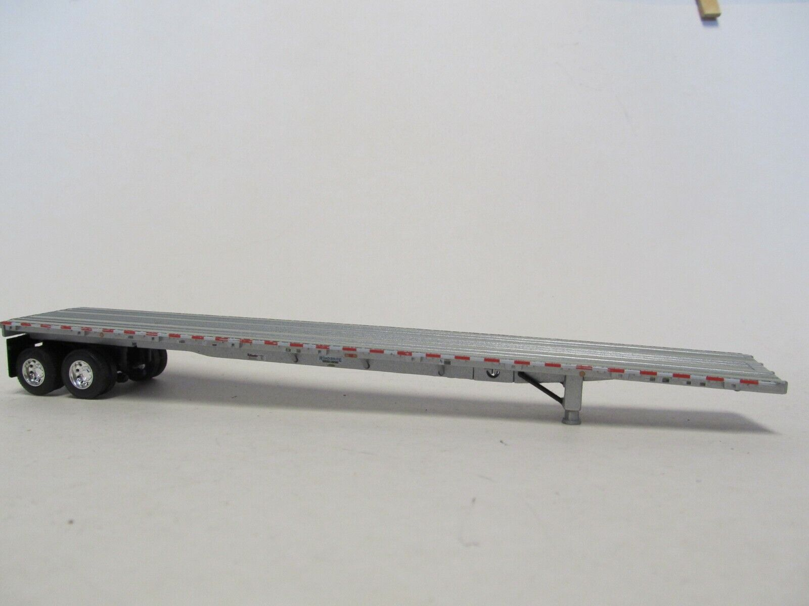 1  DCP 1/64 SCALE  ROAD  BRUTE  FLATBED  TRAILER SILVER DECK WITH SILVER FRAME