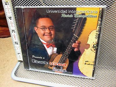 Photo RICARDO COLOMA Puerto Rican cuatro guitar CD Down's Syndrome Interamericano