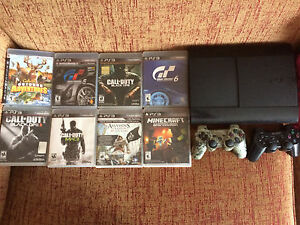 500gb PS3 with 2 controllers and 8 games