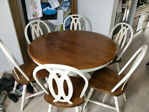 Round timber extendable dining table(on hold pending pick up)