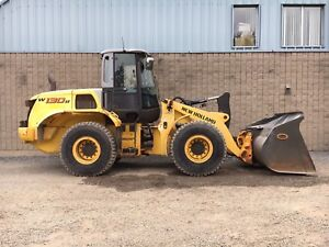 New holland W130 2011 attache rapide + godet a neige