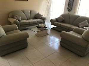 Couches, dining table and stand with glass shelves for sale
