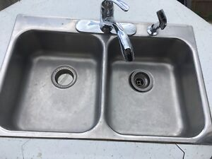Stainless steel double sink, taps, and garburator