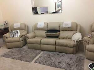 Cream Leather three seater recliner lounge and two recliner chairs