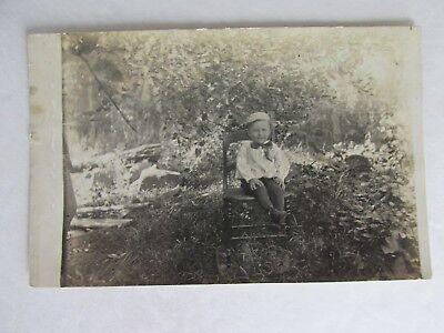 Cute Scene Boy (E443 Postcard RPPC Cute little boy on a Chair outside nature scene hat)