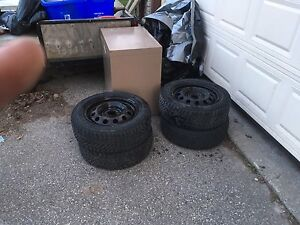195x60x15 winter tires with steel rims.