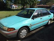 1991 Ford Laser 4 door sedan Wyong Wyong Area Preview
