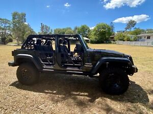 2015 Jeep Wrangler Unlimited Sport (4x4) 5 Sp Automatic 4d Sof...