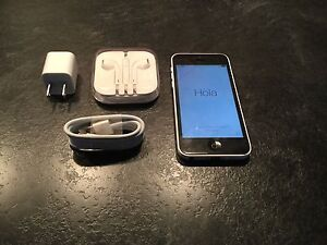 Iphone 5c /white back / with new charger and earbuds