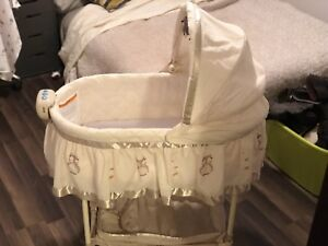 Bassinet with music, light and vibrate