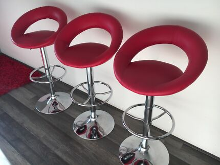 3x red leather bar stools