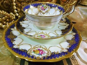 ANTIQUE-CAULDON-TEA-CUP-AND-SAUCER-TRIO-COBALT-SWAG-HP-FLORAL-LUSH-GOLD-1904