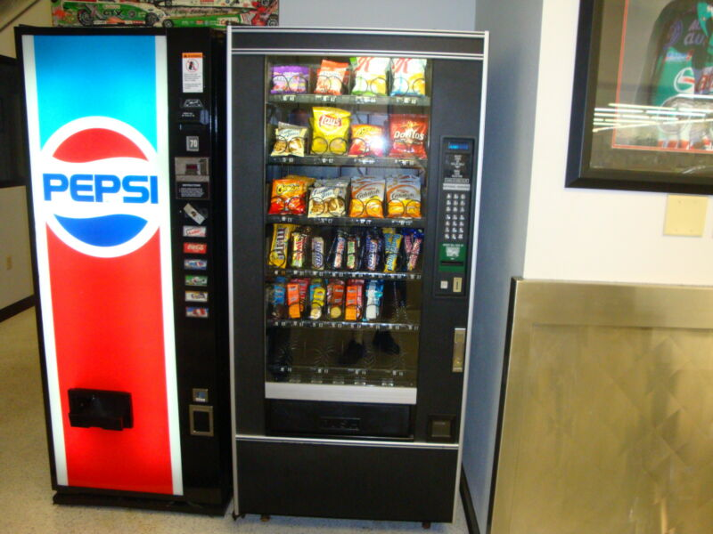 National Vendors 148 Glass Front Snack Vending Machine Refurbished